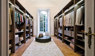 Admirable-Walk-In-Closet-Ideas-Applying-Wooden-Flooring-Completed-with-Clothes-Rack-and-Cabinet-Lightings-also-Furnished-with-Black-Tufted-Round-Chair-on-White-Soft-Rug